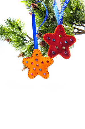 christmas pussy: Christmas abstract with star decoration, holly and fir hanging on a pussy willow branch with mistletoe over white background. Stock Photo