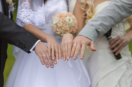 pairs: Hands with wedding rings two pairs