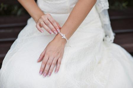 wrist cuffs: Wedding gloves on hands of bride, close-up