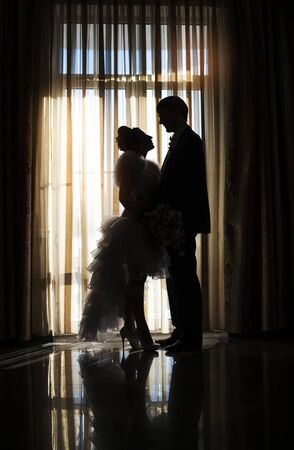 rich couple: Silhouette of bride and groom in wedding day