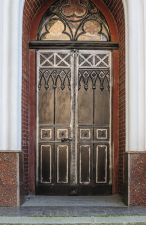 door decoration in forged iron Old town