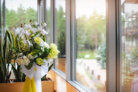 Arrangement of flowers in the window
