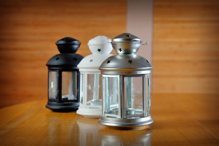 candleholder: three beautiful lanterns made of glass and decorated with metal wire