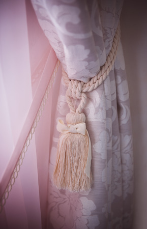 yellow tassel: curtain hold back by tassel
