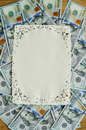 one hundred dollars: One hundred dollars pile as background frame for text.