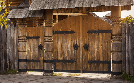 closed community: wooden gate, cutting wood