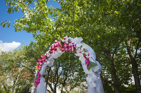 wedding arch with white and pink flowers photo