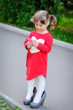 big shoes: little girl in big shoes