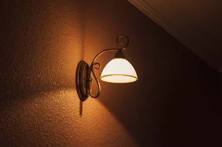 Lighted classic lamp on the wall Stock Photo