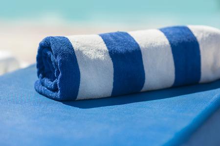 towel: towel on a sun lounger on the beach. Stock Photo