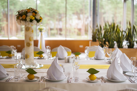 hall monitors: Served table with dishes and glasses. Stock Photo