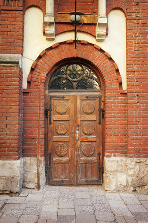 view of a wooden doorway: Old wooden door, the city of Lviv. Stock Photo