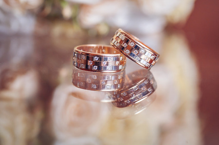 booked: A pair of wedding rings with bokeh .