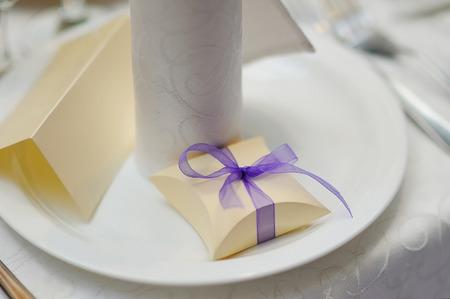 bonbonniere: Wedding bonbonniere box with purple bow.