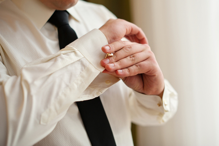 french cuffs: Men wear cufflinks on a shirt sleeve