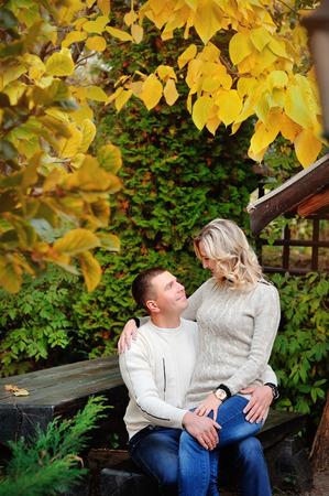 lovely couple: Lovely couple in autumn park. Stock Photo
