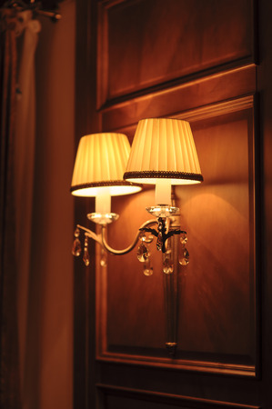 lit lamp: Electric lamp is lit at night. Stock Photo