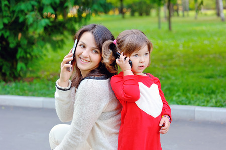 Mom with baby talking on phone.