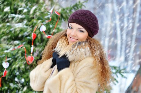 snows: Girl in winter snows, in a mink coat outdoors. Stock Photo