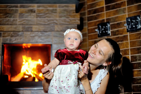 daughter with her mother at the fireplace.