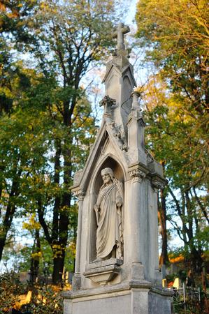 lviv: Old statue in Lychakiv Cemetery in Lviv, Ukraine, October 2014.