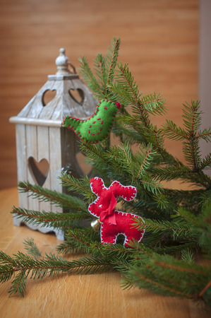 deer in heart: Christmas candle holder with heart, with Christmas tree decorated with bird and deer. Stock Photo