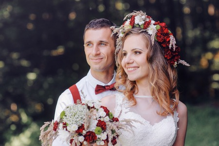 Happy bride and groom walking in spring day. Stock Photo - 41784306
