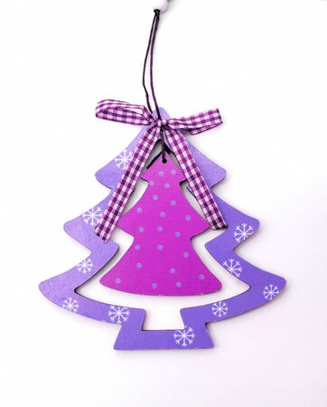 Christmas decorations Christmas tree in purple on a white . photo