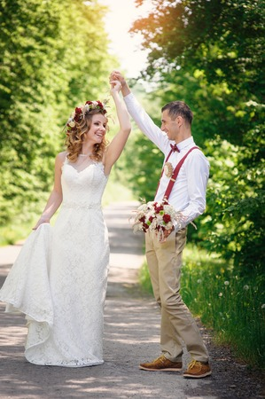 Bride and Groom at wedding Day walking Outdoors on spring nature
