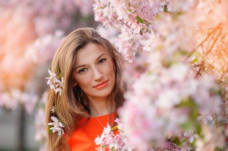 beautiful woman in spring blossom. Archivio Fotografico