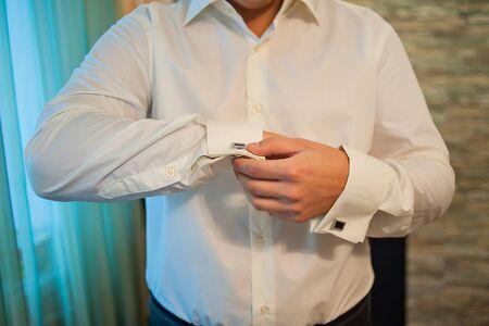 wrist cuffs: man in a dress shirt cufflinks. Stock Photo