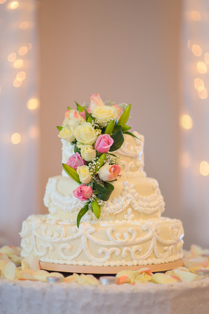 traditional and decorative wedding cake at wedding reception.