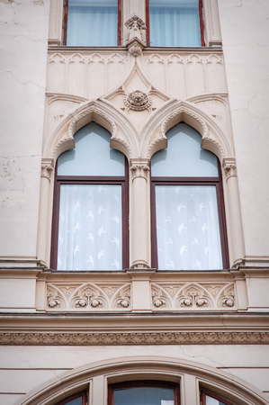 heads old building facade: beautiful sculpture window oriental style.