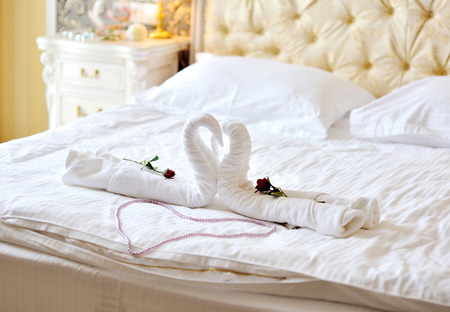 heart suite: swans out of towels on the bed. Stock Photo