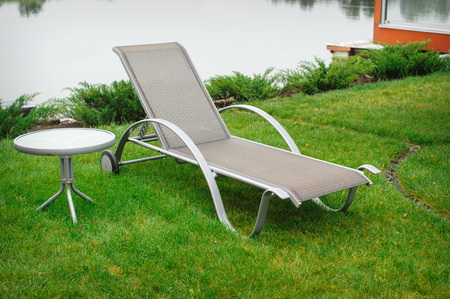 chaise lounge: chaise lounge on the banks of the river.