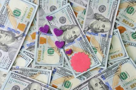 avarice: Hearts lie on money dollars, concept of love for money