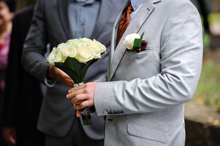buttonhole: bride with a wedding bouquet and buttonhole.