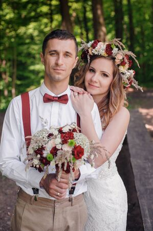 yellow dress: happy bride and groom walking in the forest Stock Photo
