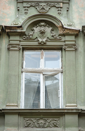 heads old building facade: beautiful sculpture window classic style green.