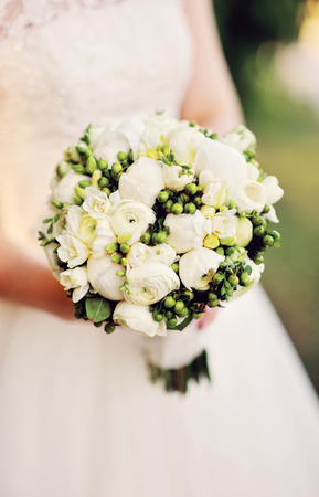 bride holding a bouquet of gorgeous white.