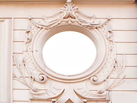 moldings: Ancient brick wall with ornate decorative stucco moldings frame plate. Architectural background.