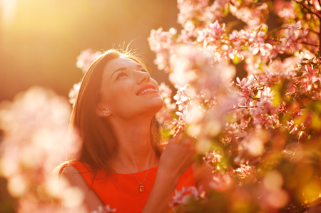spring fashion: Pretty spring woman in the garden. Stock Photo