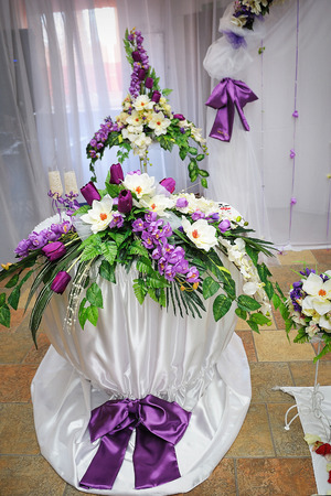 dowry: wedding decoration in purple style table with flowers. Stock Photo