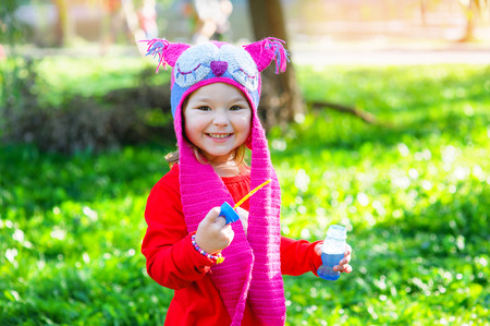 jungle girl: Portrait of happy little girl in the park in the header of an owl. Stock Photo