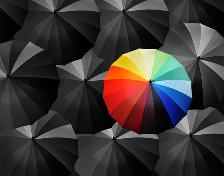 distinguish: colored umbrellas on a black background. Stock Photo