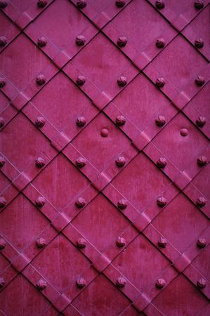 Texture chipped metals doors dark red color.
