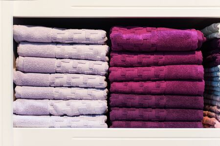 soft sell: Two stacks of towels on a shelf in the store. Stock Photo