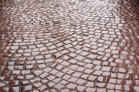 road paving: background of wet road paving.