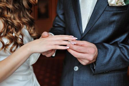 groom dresses bride wedding ring.