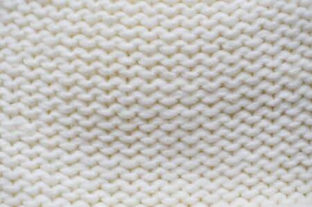 garments: texture of white knitted garments purl loop.